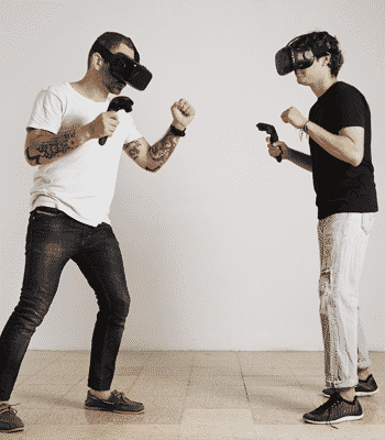 Two guys playing VR opposite eachother.