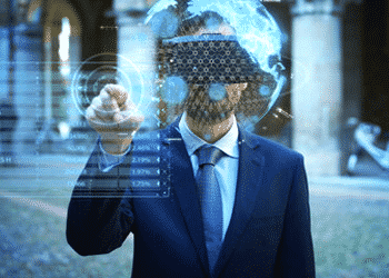 Guy with vr gogole using finger to click somethin on hologram.
