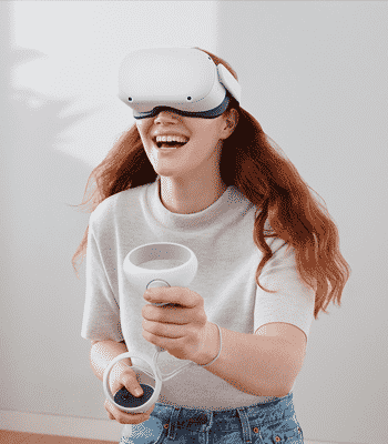 Women with oculus quest 2 on head playing and smiling.